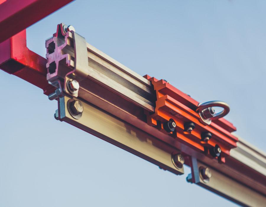 Rail rigide horizontal et chariot